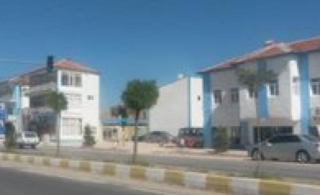Ayranci'da Binalar Mavi Beyaza Boyaniyor