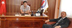 Baskan Samur'dan Kaymakam Ilhan'a Hosgeldin Ziyareti