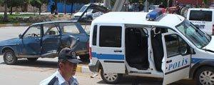 Polis Araciyla Otomobil Çarpisti: Iki Yarali