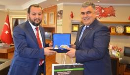 Başkan Özgüven, KMÜ Rektörlüğüne Atanan Akgül'ü...