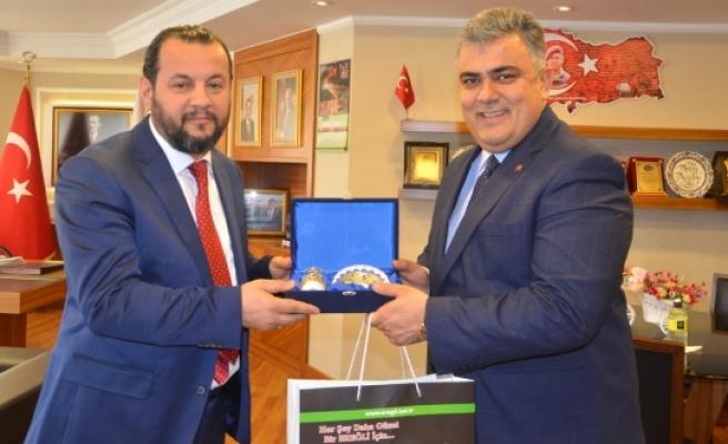 Başkan Özgüven, KMÜ Rektörlüğüne Atanan Akgül'ü Ağırladı